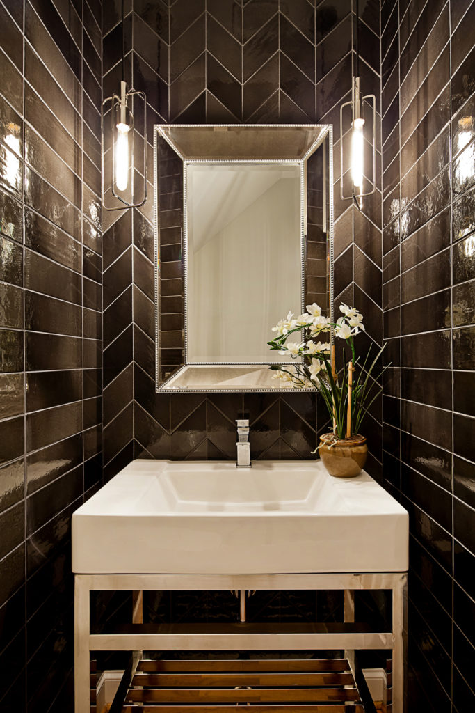 horizontal soldier stack tile with chevron accent wall in powder room; Tile Design Ideas in Charlotte, NC