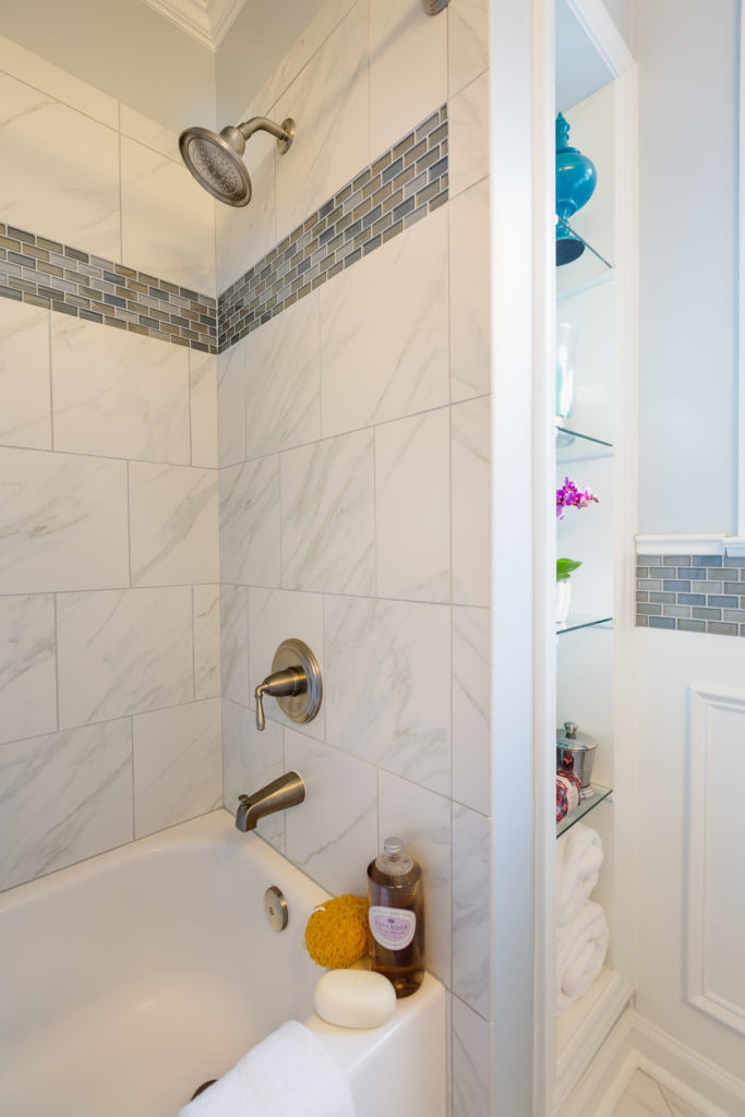 Square running bond tile shower with mosaic accent band; Tile Design Ideas in Charlotte, NC