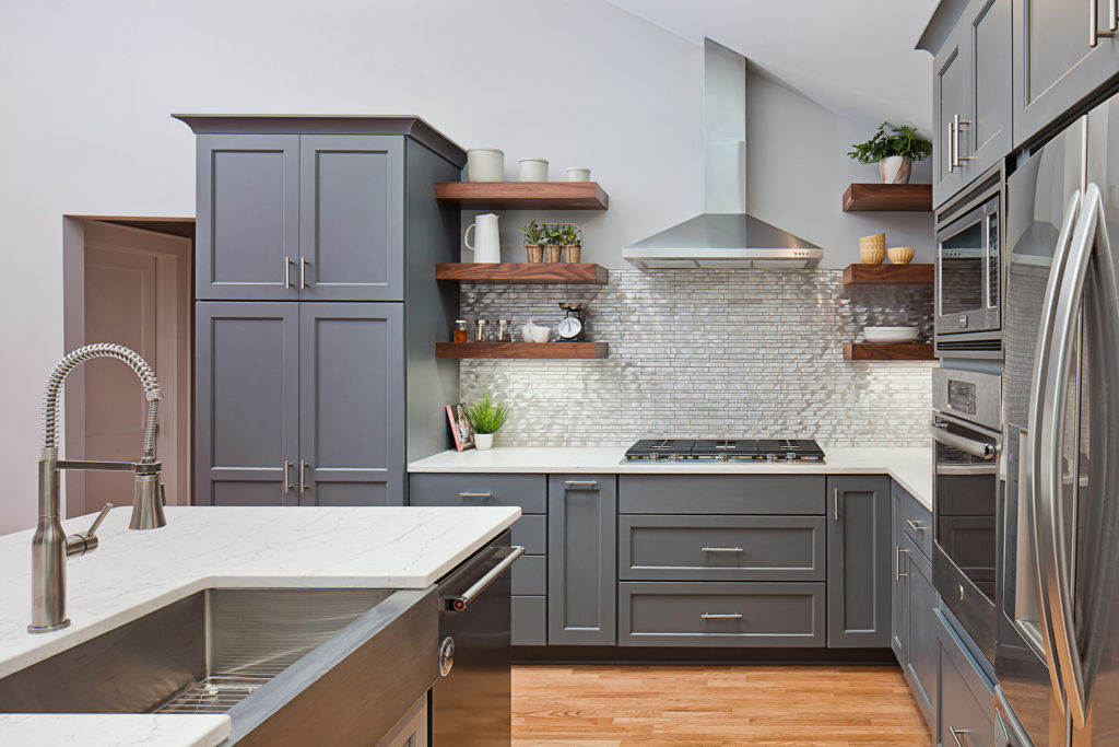 Stainless steel linear mosaic backsplash with walnut floating shelves; Tile Design Ideas in Charlotte, NC