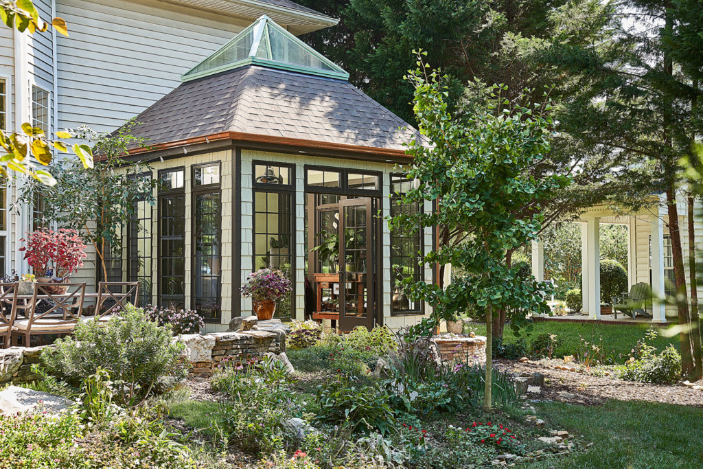 Four-season sunroom addition with glass roof in Huntersville, NC