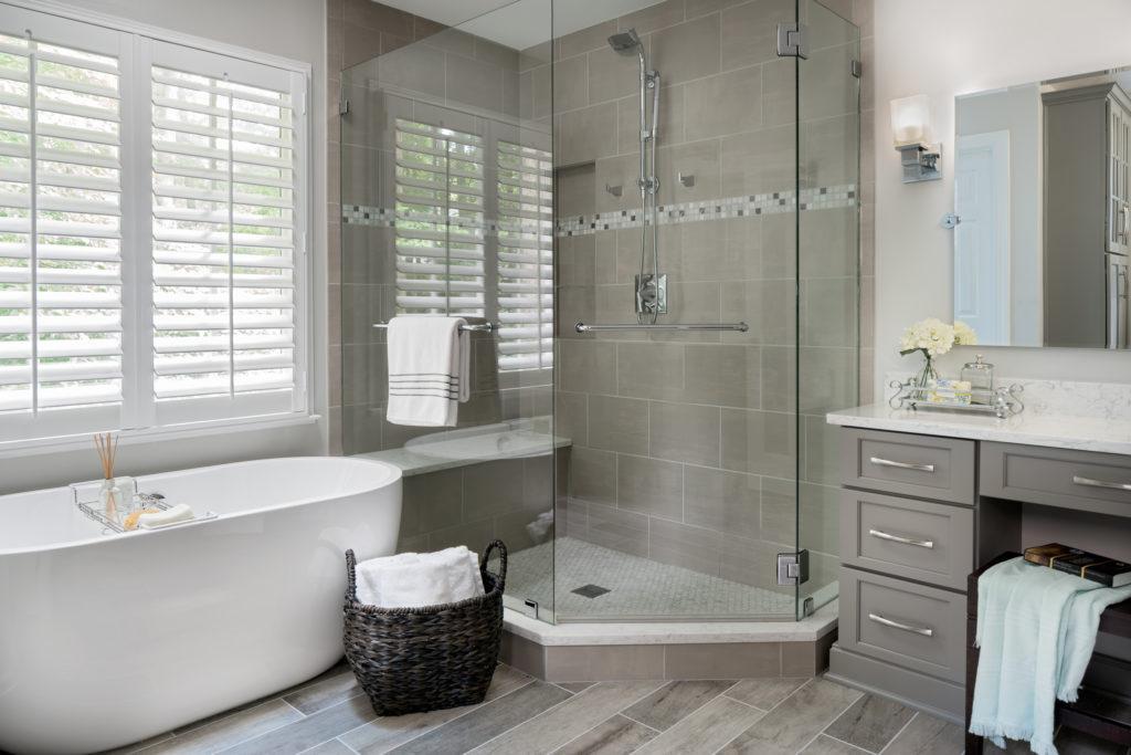Grey toned wood look porcelain tile flooring in a master bath