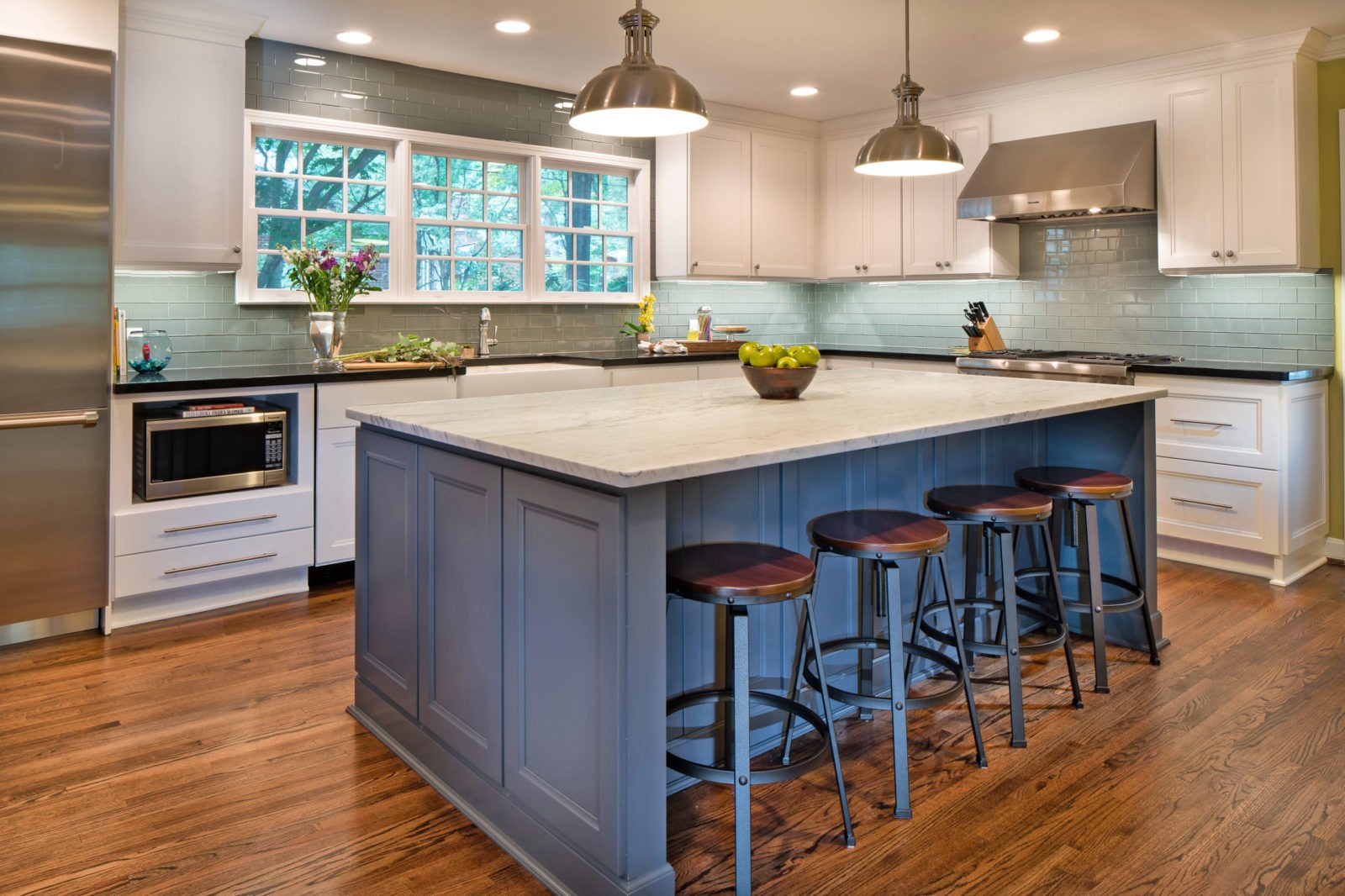 Honed Carrara marble on this dark gray island creates a focal point in this Charlotte, NC kitchen remodel