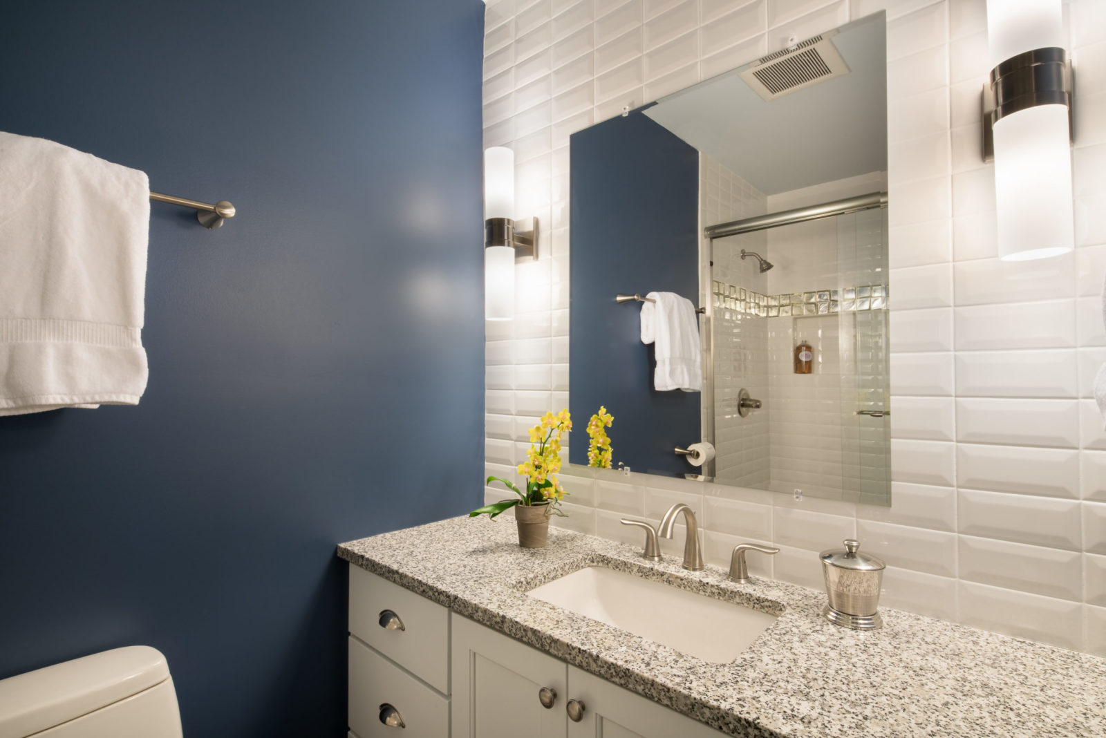 This common speckled granite was a sensible and inexpensive selection fo this little boys bathroom