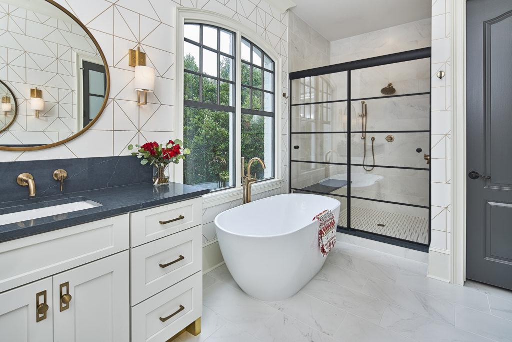 Modern, yet classic master bathroom makeover with black framed shower glass