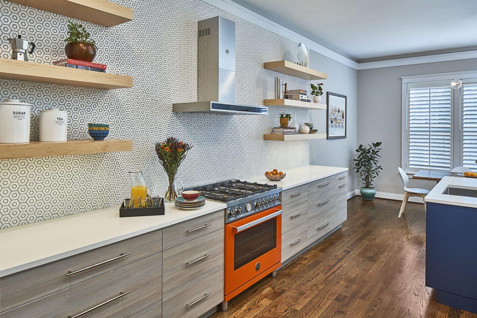 orange range in a modern kitchen with mosaic tile backsplash