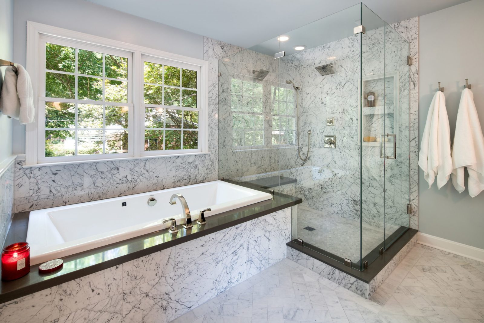 Marble shower with deck mounted tub