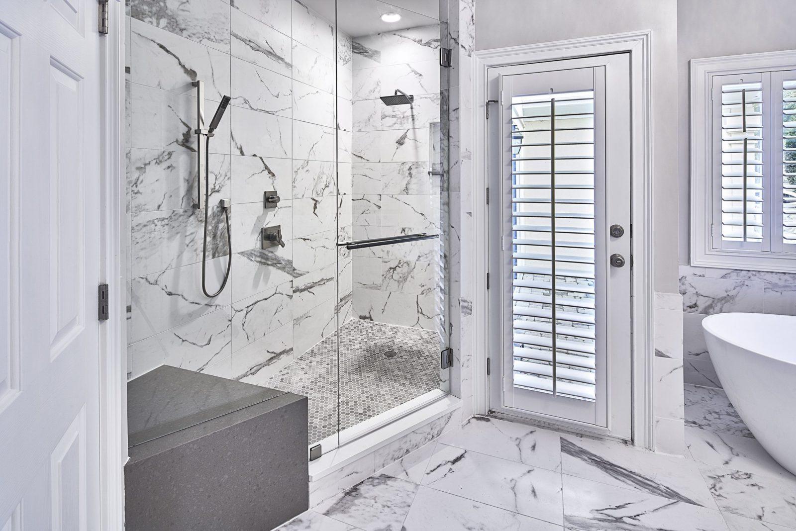 Alcove shower design with quartz bench; shower upgrades