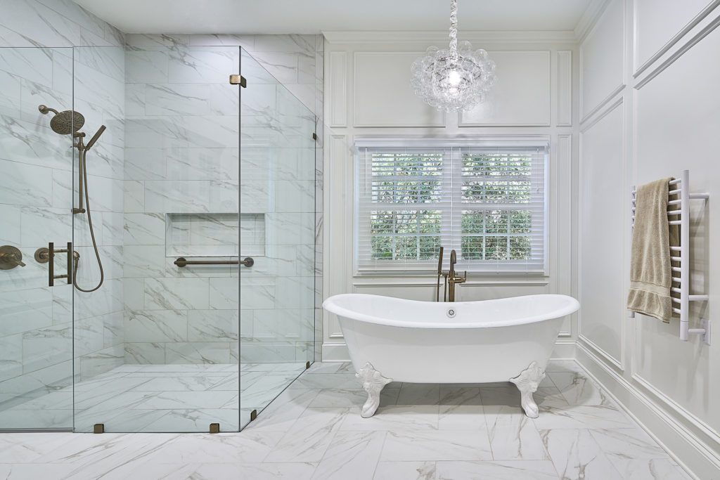 Upgraded curbless sheer shower upgrades with clawfoot tub and picture frame molding