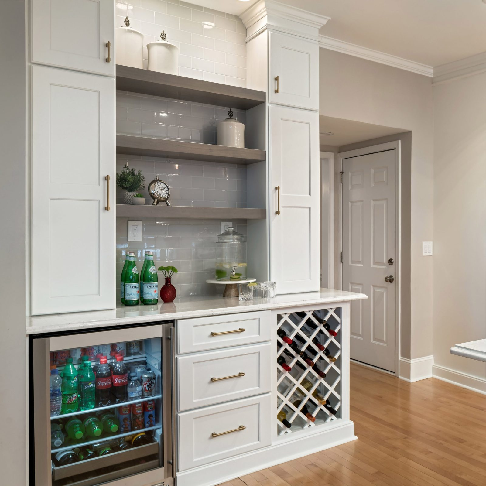 Home bar with open shelves, wine storage and white cabinets