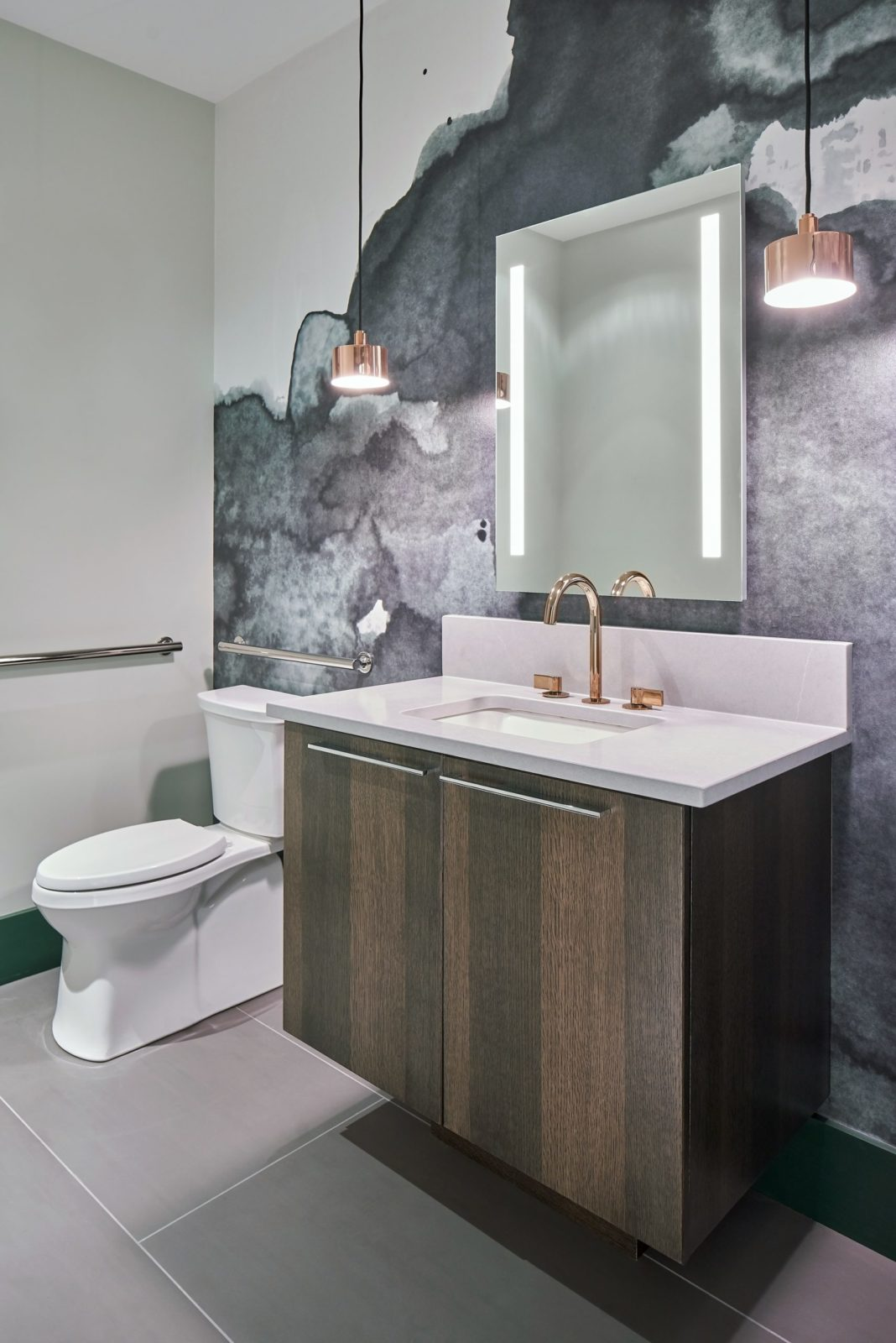 Contemporary bathroom with quarter sawn white oak floating vanity, rose gold pendants and smokey green wallpaper