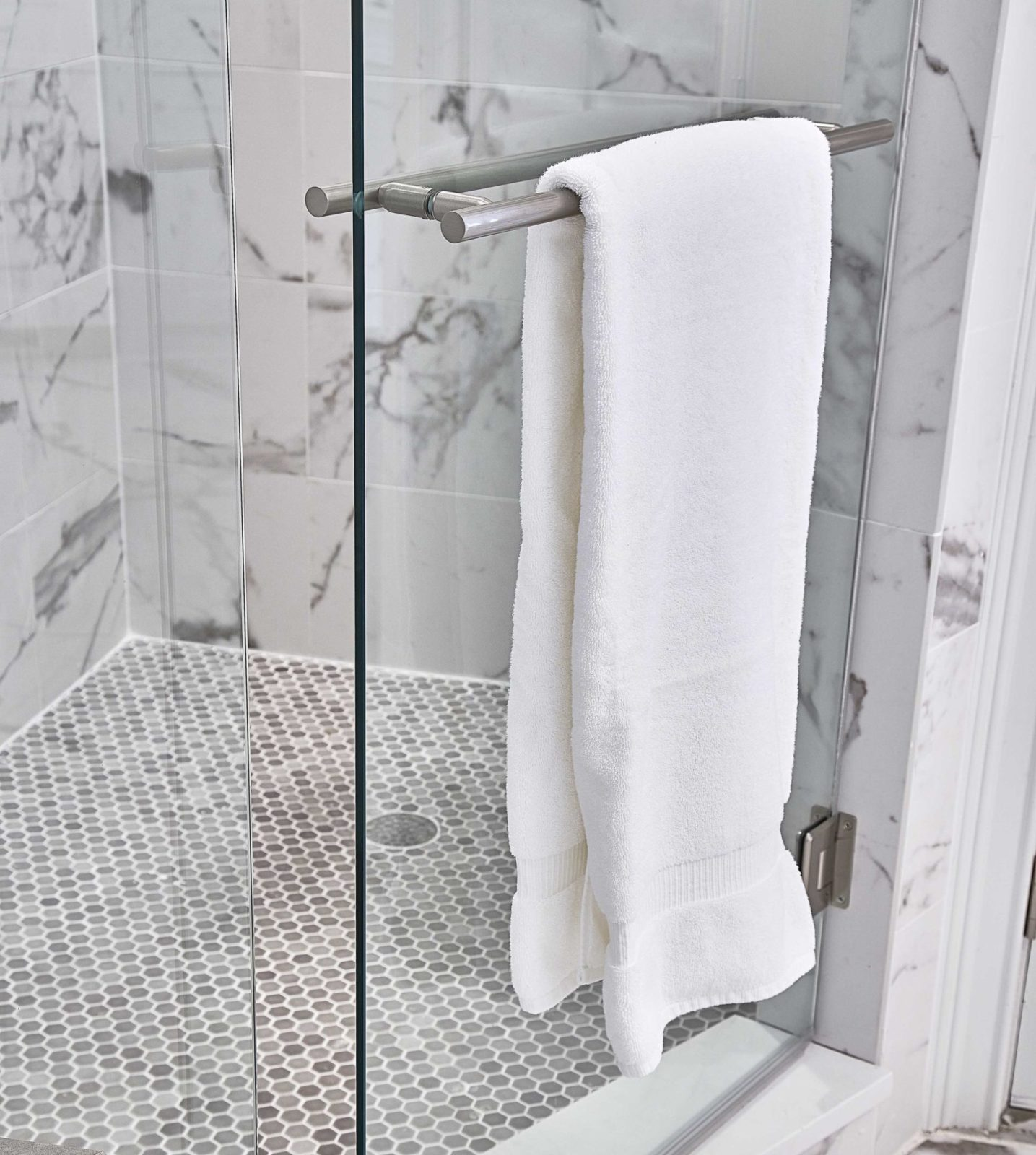 revision-design-towel-bar-in-shower-glass