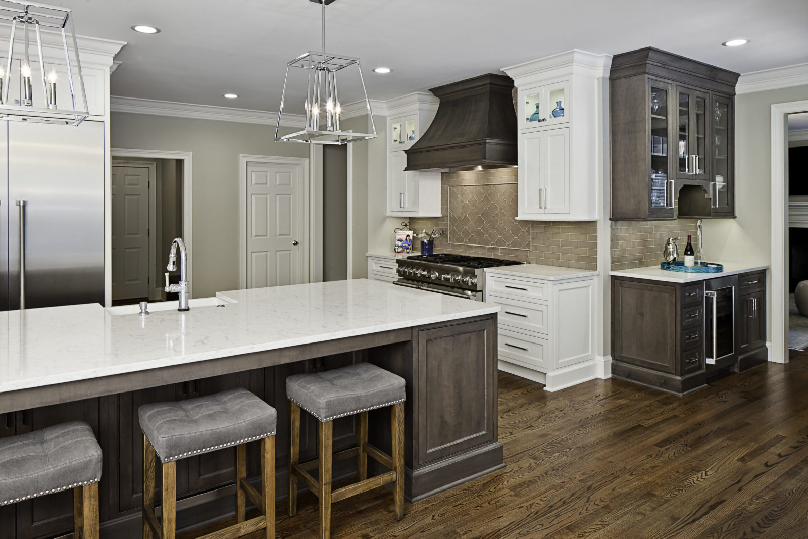 designer-kitchen-white-cabinets-gray-hood